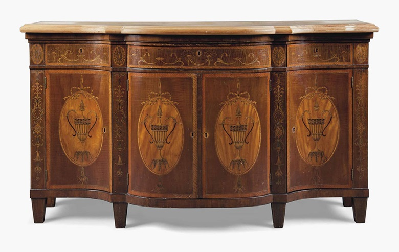 A late Victorian mahogany and marquetry serpentine side cabinet. Of George III style, late 19th century. 35 ½ in (90 cm) high; 61 ½ in (156 cm) wide; 19 ¾ in (50.5 cm) deep. This lot is offered in Interiors on 17 August 2016 at Christie's in London, South Kensington