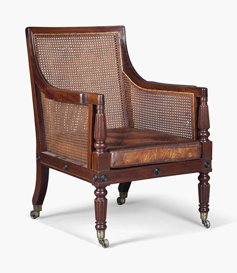 A Regency mahogany caned library bergère. Early 19th century. 37½ in (95 cm) high; 25½ in (65 cm) wide. This lot was offered in Interiors on 17 August 2016 at Christie's in London, South Kensington and sold for £3,500