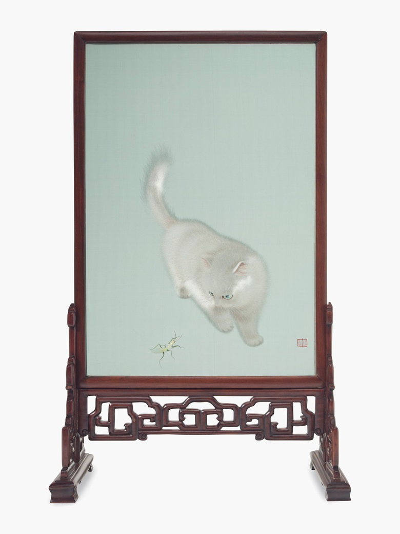 A Chinese embroidered silk screen mounted in a carved wood stand, circa 1984. The embroidery depicting a white cat playing with mantis. 26 ¼ (66.6 cm) high, 14 ⅝ in (37.1 cm) wide. Estimate $3,000-5,000. This lot will be offered in The Private Collection of President and Mrs. Ronald Reagan, 21-22 September at Christies in New York