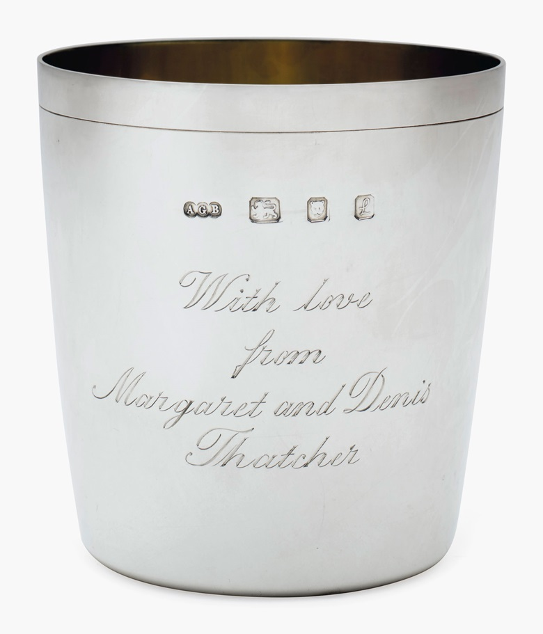 A pair of Elizabeth II silver beakers, Mark of Gerald Benney, London, 1985 and 1990. Each with gilt interior, inscribed 'With love from Margaret and Denis Thatcher' to one side, the reverse each with an initial R or N, marked Gerald Benney, London on base, and marked on rim. 3 ⅜ in (8.6 cm) high; 11 oz 10 dwt (360 g). Estimate $1,000-2,000. This lot will be offered in The Private