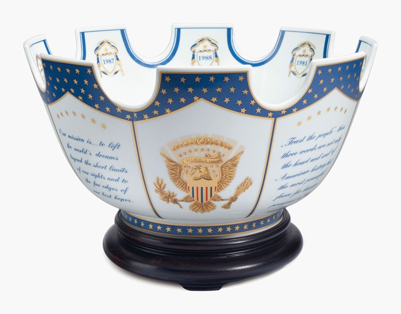 A Mottahedeh porcelain Chinese export-style presidential presentation monteith on wood stand. Modern, blue printed mark. The exterior richly gilded with panels of the Presidential seal alternating with quotes from President Reagan, the interior centred by the Presidential seal and eight shields dated for each year of the Reagan Administration, the underside inscribed, PRESENTED BY THE PRESIDENT