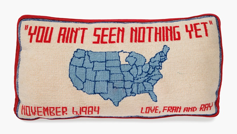 A monogrammed needlepoint pillow, circa 1984. Embroidered with a map of the United States and YOU AIN'T SEEN NOTHING YET, NOVEMBER 6, 1984, LOVE, FRAN AND RAY. 19 in (48.5 cm) wide. Estimate $1,000-1,500. This lot will be offered in The Private Collection of President and Mrs. Ronald Reagan, 21-22 September at Christies in New York