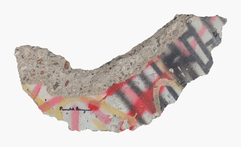 Ronald Reagan (1911-2004). His signature ('Ronald Reagan') accomplished in black felt-tip pen on the surface of a sizeable graffiti-strewn fragment of the Berlin Wall. Approximately 25 in long, 13 in high and 2 in thick. Provenance Formerly in the Collection of President and Mrs. Ronald Reagan. Estimate $10,000-20,000. This lot will be offered in The Private Collection of President and