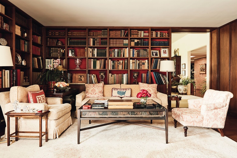 A view of the library with its shelves housing leather-bound volumes, movie scripts and gifts received while the Reagans were at the White House