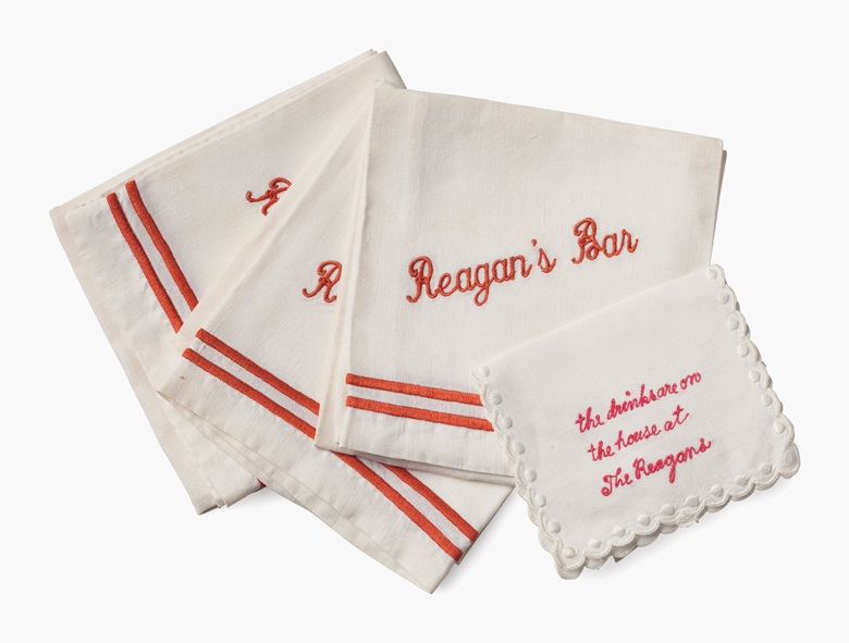 The Reagans' Bar — A group of bar napkins, second half 20th century. Comprising five large napkins embroidered 'Reagan's Bar' and a smaller napkin embroidered 'the drinks are on the house at The Reagans'. Estimate $200-400. This lot will be offered in The Private Collection of President and Mrs. Ronald Reagan, 21-22 September at Christies in New York
