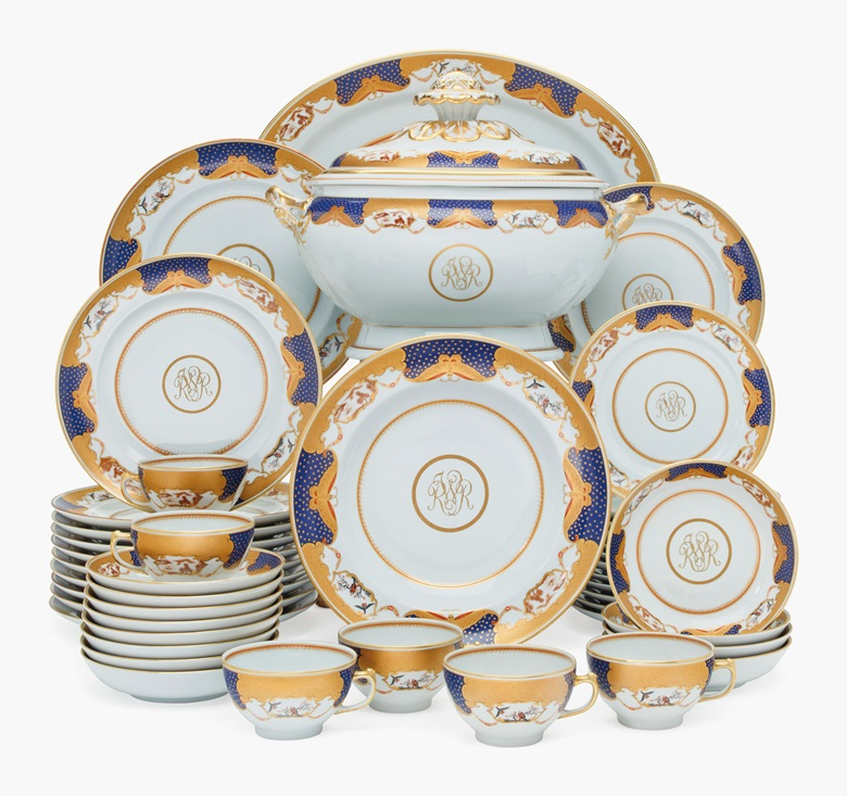 President Reagan's Mottahedeh Porcelain Chinese Export-style monogrammed part dinner service, modern, green printed marks. The cobalt-blue border gilt with stars, trellis and butterflies among alternating landscape and bird vignettes, with gilt 'RWR'  monogram, comprising an oval soup tureen and cover, a large oval platter, 11 dinner plates, 17 soup plates, 11 lunch plates,