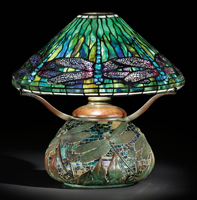 Tiffany Studios, A dragonfly leaded glass, bronze and mosaic table lamp, circa 1905. 17¼ in (43.6 cm) high, 16½ in (41.8 cm) diameter of shade. Sold for $602,500 on 8 December 2009