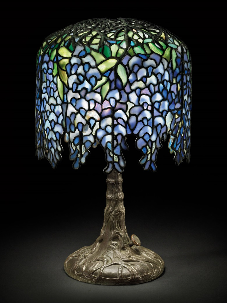 Tiffany Studios, A 'Pony Wisteria' table lamp, circa 1910. Leaded glass, bronze. 17 in (43.2 cm) high, 10¼ in (26 cm) diameter of shade. Sold for $221,000 on 19 December 2013