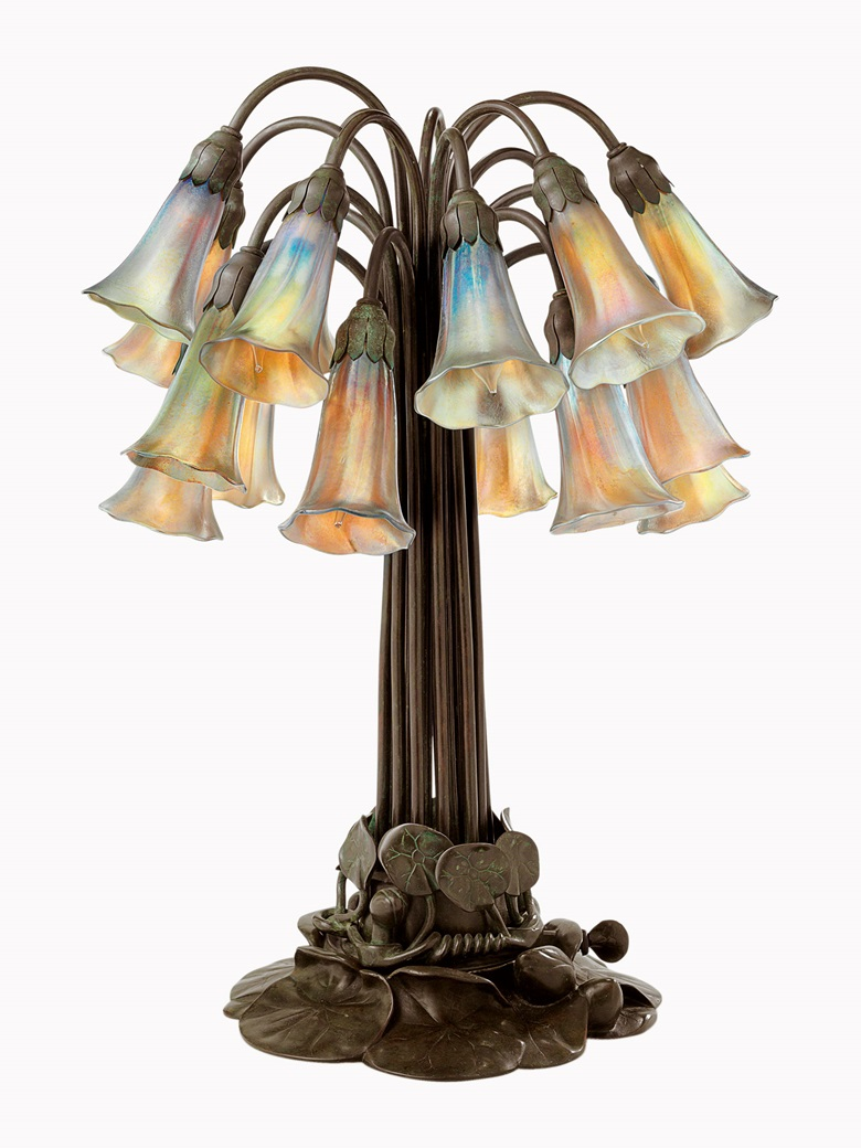 Tiffany Studios, An 18-light 'Lily' table lamp, circa 1910. Favrile glass, bronze. 21½ in (54.5 cm) high. Sold for $68,750 on 12 June 2014