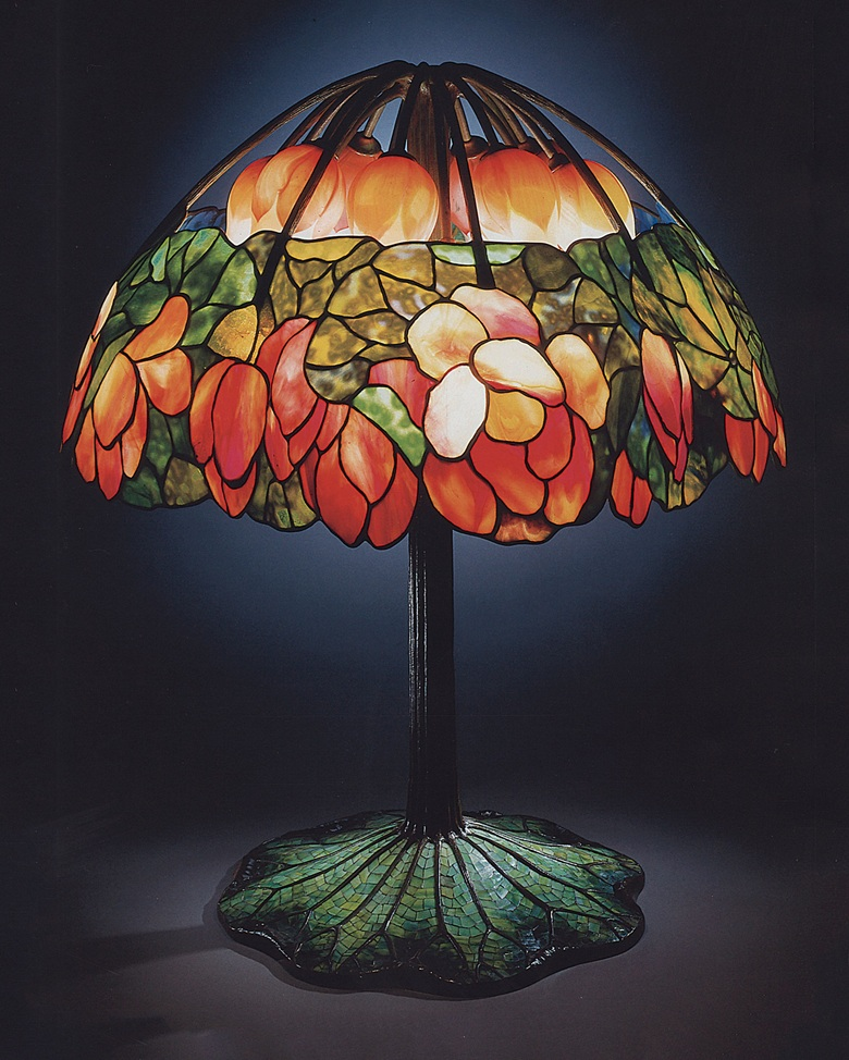 Tiffany studios a leaded glass bronze and mosaic lotus lamp circa