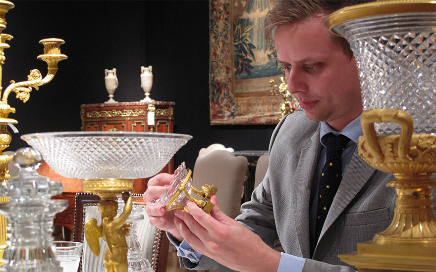 Specialist Paul van den Biesen inspects the Baron Per Adolf Tamm ormolu and cut-glass table service, attributed to Pierre-Philippe Thomire (1751-1843)