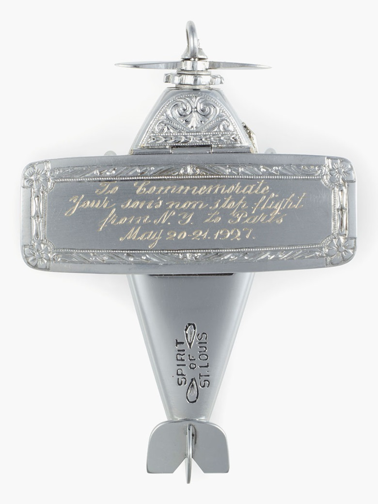 Milos & Diel Watch Case Company. A Fine, Historically Important and Unique 14k White Gold Model Airplane-form Watch Made for the Mother of American Aviator Charles Lindbergh. Sold for $35,000 on 7 June 2016