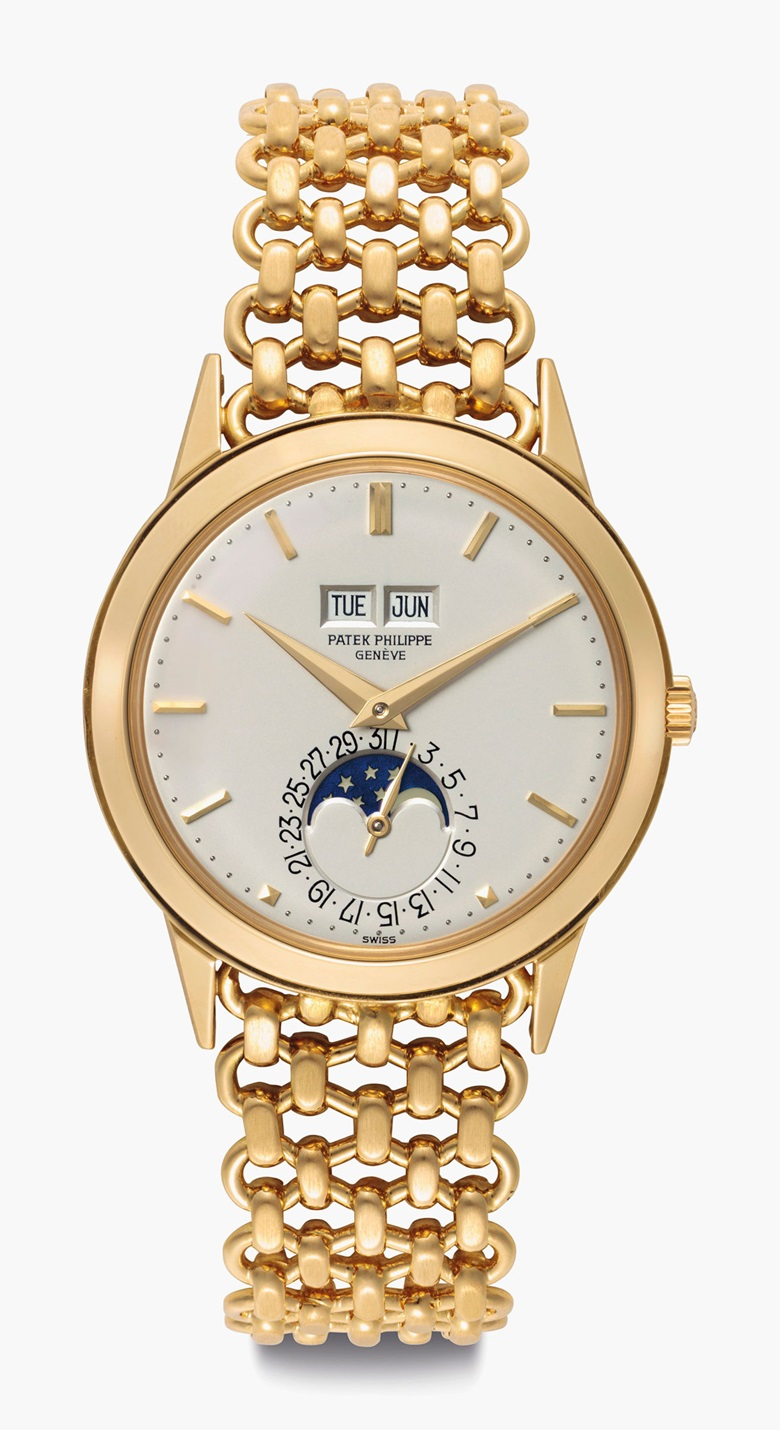 Patek Philippe. An Extremely Fine and Rare 18k-Gold Automatic Perpetual Calendar Wristwatch with Moon Phases and Bracelet. Sold for $100,000 on 7 June 2016