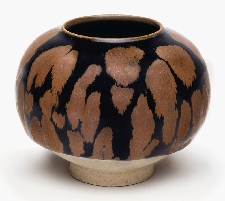 A russet-splashed black-glazed globular jar, Northern Song-Jin Dynasty (960-1234). 4 ⅞ in (12.5 cm) wide, Japanese wood box. Estimate $20,000-30,000. This work is offered in The Classic Age of Chinese Ceramics The Linyushanren Collection, Part II sale on 15 September at Christie's New York