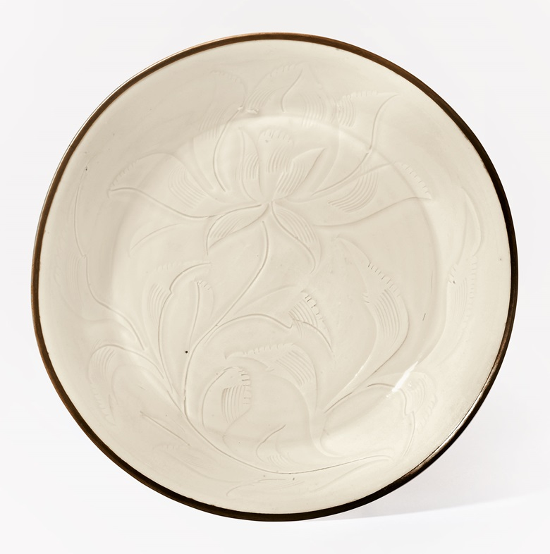 A fine and rare ding carved lotus dish, Northern Song Dynasty, 11th-12th century. 6 ½ in (16.5 cm) diameter, double box. Estimate $300,000-500,000. This work is offered in The Classic Age of Chinese Ceramics The Linyushanren Collection, Part II sale on 15 September at Christie's New York