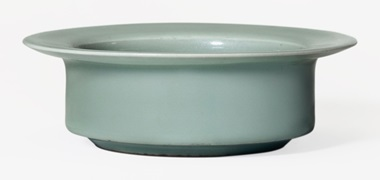A rare Longquan celadon brush washer, Southern Song Dynasty (1127-1279). 5 ¾ in (14.5 cm) diameter, Japanese wood box. Estimate $500,000-700,000. This work is offered in The Classic Age of Chinese Ceramics The Linyushanren Collection, Part II sale on 15 September at Christie's New York