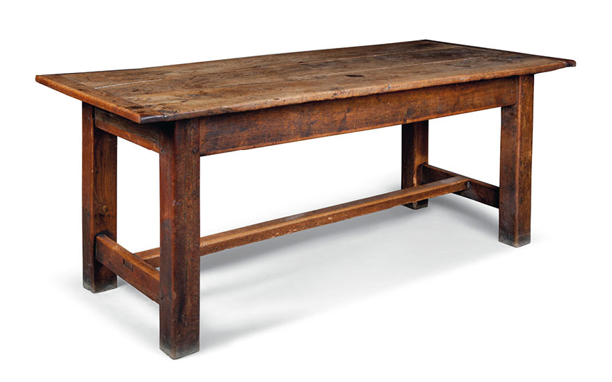 A George III figured oak farmhouse table. Late 18th century, Welsh or Welsh Borders. 31 ¾ in. (81 cm.) high; 77 ½ in. (197 cm.) long; 35 in. (89 cm.) wide Estimate £1,500-2,5000