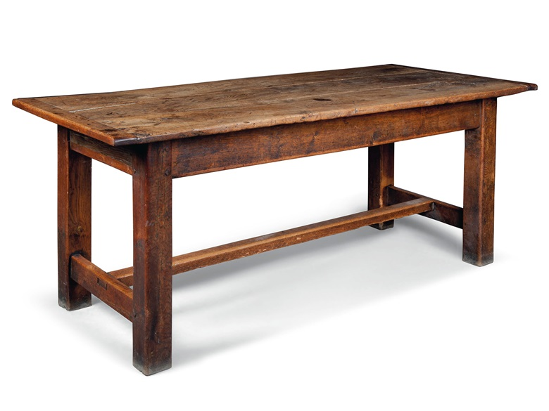 A George III figured oak farmhouse table. Late 18th century, Welsh or Welsh Borders. 31 ¾ in (81 cm) high; 77 ½ in (197 cm) long; 35 in (89 cm) wide. Estimate £1,500-2,500. This lot is offered in the Interiors sale on 17 August at Christies South Kensington