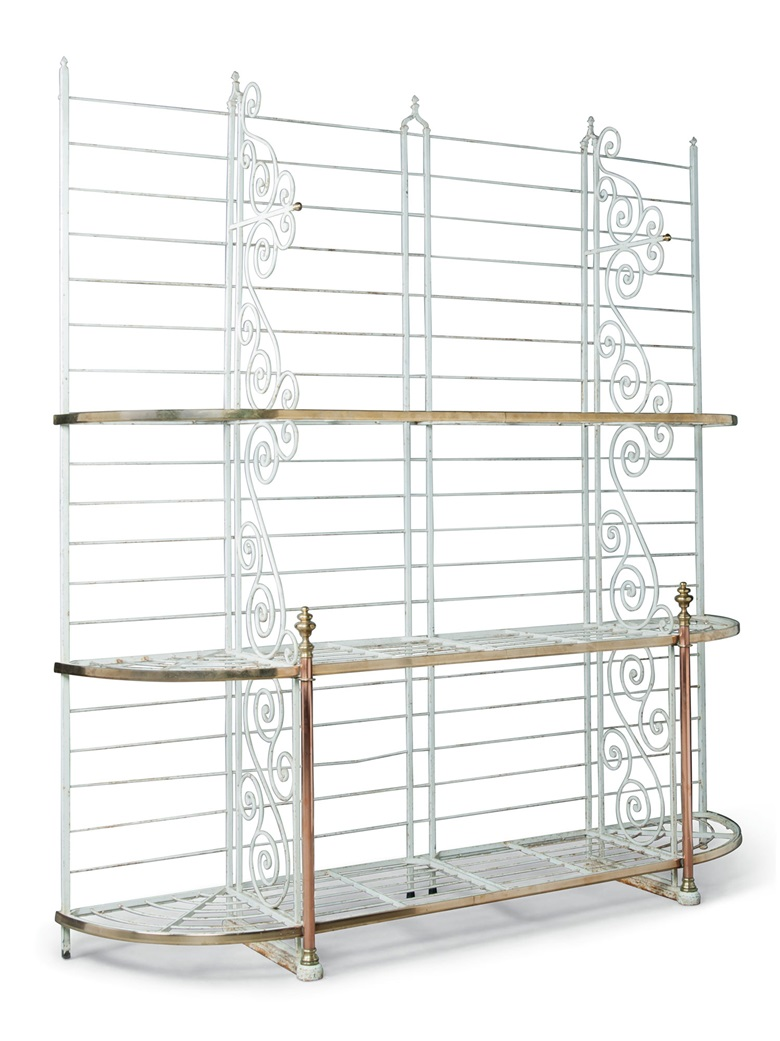 A French painted-iron baker's rack. Late 19thearly 20th century. With brass and copper mounts supporting slatted shelves. 87 in (221 cm) high; 80 in (203 cm) wide; 20 in (51 cm) deep. Estimate £1,000-1,500. This lot is offered in the Interiors sale on 17 August at Christies South Kensington