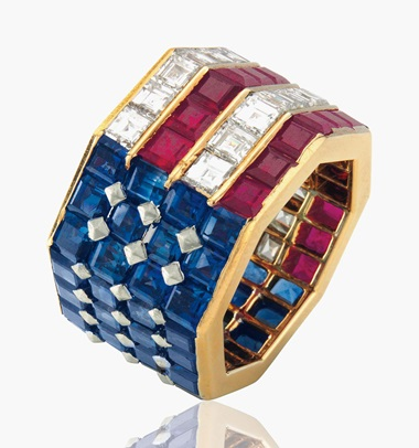 A diamond, sapphire and ruby ring, by Bulgari. Set with square-cut sapphires, rubies and diamonds in an American flag motif, ring size 5 ½. Estimate $5,000-7,000. This lot will be offered in The Private Collection of President and Mrs. Ronald Reagan, 21-22 September at Christies in New York