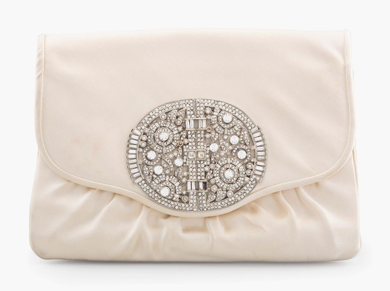 A cream satin envelope clutch bag with crystal Art Deco ornament, Judith Leiber, 1984. Estimate $300-500. This lot will be offered in The Private Collection of President and Mrs. Ronald Reagan, 21-22 September at Christies in New York