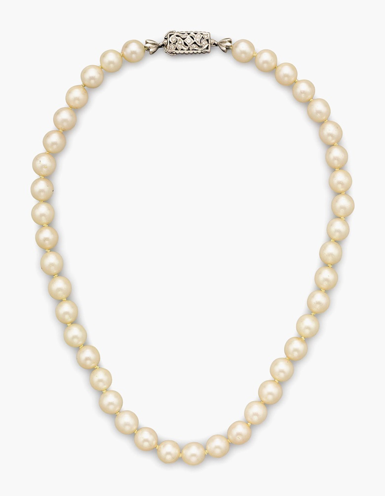Cultured pearl and diamond necklace. Designed as a strand of cultured pearls with a diamond and white-gold clasp. Metal 18k. Diamonds 11 round diamonds with approximate total weight of 0.15 carats. Cultured pearls 41 round cultured pearl beads measuring approximately 8.5 mm. 16½ inches in length. Marks ITALY, 18K. Gross Weight 41.9 grams. Estimate $1,000-$1,500. This lot is offered in the