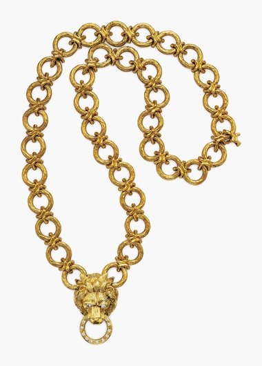 A diamond and gold lion pendant-brooch necklace, by Van Cleef & Arpels. Suspending a detachable pendant-brooch, designed as sculpted and textured 18k-gold lions head with circular-cut diamond eyes. Estimate $30,000-50,000. This lot will be offered in The Private Collection of President and Mrs. Ronald Reagan, 21-22 September at Christies in New York
