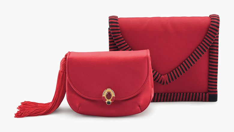A red satin tassel boroso clutch bag with cabochon and a red and black grosgrain envelope clutch bag, Judith Leiber and Yves Saint Laurent. Estimate $400-600. This lot will be offered in The Private Collection of President and Mrs. Ronald Reagan, 21-22 September at Christies in New York