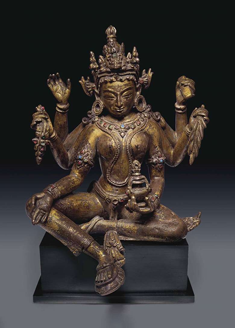 An important gilt bronze figure of Vasudhara. Nepal, 13th century