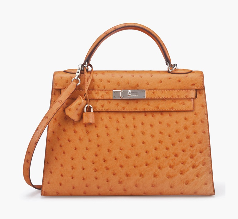 A tangerine ostrich sellier Kelly 32 bag. Hermès, 1999. 13 in wide x 9 in high x 5 in deep. Estimate $15,000-20,000. This lot is offered in Handbags & Accessories on 13-22 September 2016 at Christie's in New York, Rockefeller Plaza