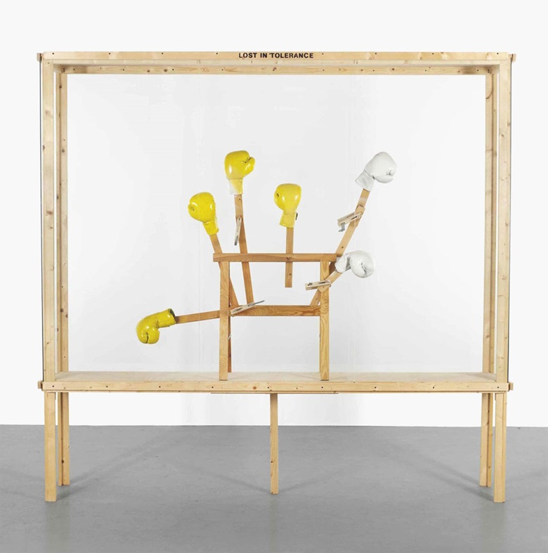 Georg Herold (b.  1947), Lost in Tolerance. Wood, glass, trestle, boxing gloves, clamps, screws and paint, 102⅜ x 108⅝ x 19¼ in (260 x 276 x 49 cm). Estimate £20,000-25,000. This lot is offered in Post-War & Contemporary Art Day Auction on 7 October 2016 at Christie's in London, King Street