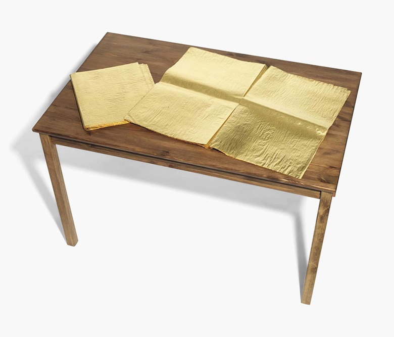Jim Hodges (b.  1957), The Good NewsLondon Guardian. 24-carat gold leaf on newspaper and wood table, closed newspaper 15⅛ x 13⅝ in (38.5 x 34.5 cm), open newspaper 23⅝ x 29⅝ in (60 x 75.3 cm), overall 47¼ x 29⅛ x 29½ in (120 x 74 x 75 cm). Estimate £15,000-20,000. This lot is offered in Post-War & Contemporary Art Day Auction on 7 October 2016 at Christie's in London,