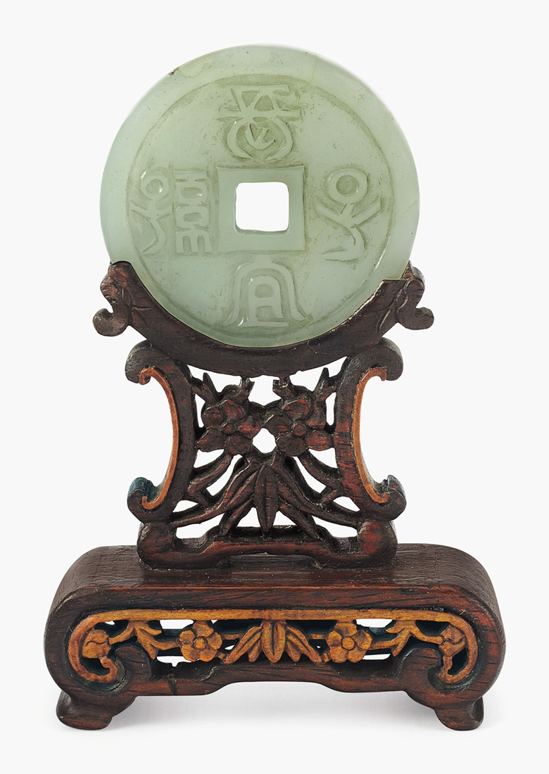 A Chinese carved pale celadon jade disc, bi, late 19th20th century. 2 in diameter the disc; 4¼ in high overall. Estimate $1,000-1,500. This lot is offered in Old Masters on 26 October 2016 at Christie's in New York, Rockefeller Plaza