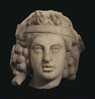 A Roman marble head of Bacchus. Circa 2nd century AD. 4⅜ in (11.1 cm) high. This lot was offered in Antiquities on 25 October 2016 at Christie's in New York
