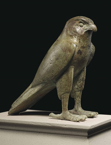 An Egyptian bronze falcon. Late period to Ptolemaic Period, 664-30 BC. 4⅞ in (12.4 cm) high. This lot was offered in Antiquities on 25 October 2016 at Christie's in New York and sold for $75,000