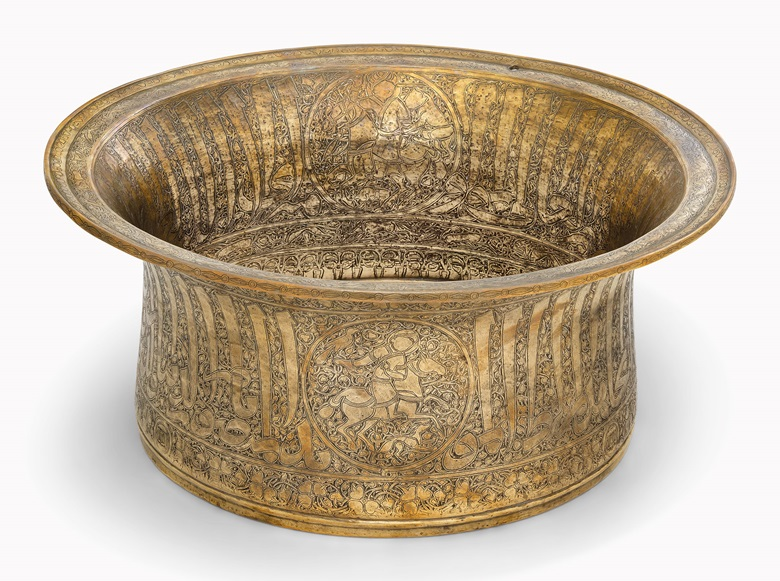 A gold and silver-inlaid brass basin made for the Mamluk Sultan Al-Nasir Muhammad Ibn Qalawun. Egypt, first half 14th century. 18⅛ in (45.7 cm) diameter at rim. Estimate £60,000-80,000. This lot is offered in Art of the Islamic and Indian Worlds on 20 October 2016 at Christie's in London, King Street
