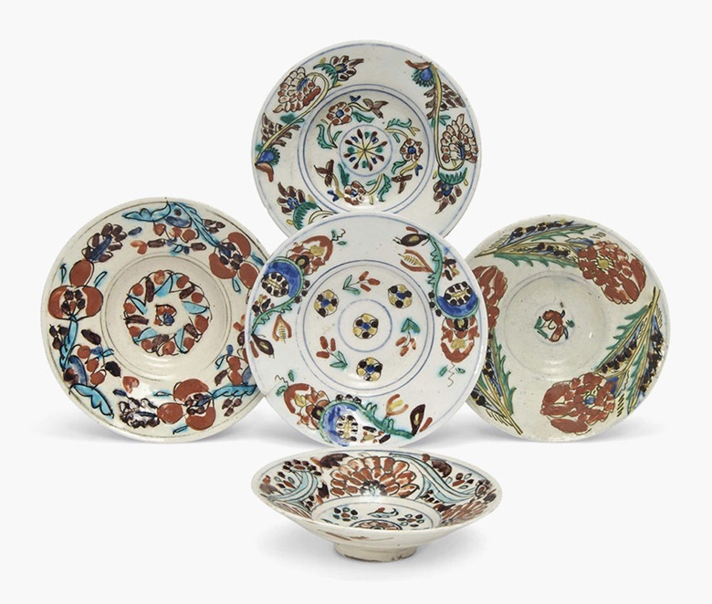 Five Kutahya pottery saucers. Ottoman Turkey, 19th century. The largest 7¾ in (19.8cm) diameter; the smallest 6⅞ in (17.5 cm). This lot was offered in Arts & Textiles of the Islamic & Indian Worlds on 21 October 2016 at Christie's in London, South Kensington and sold for £3,500