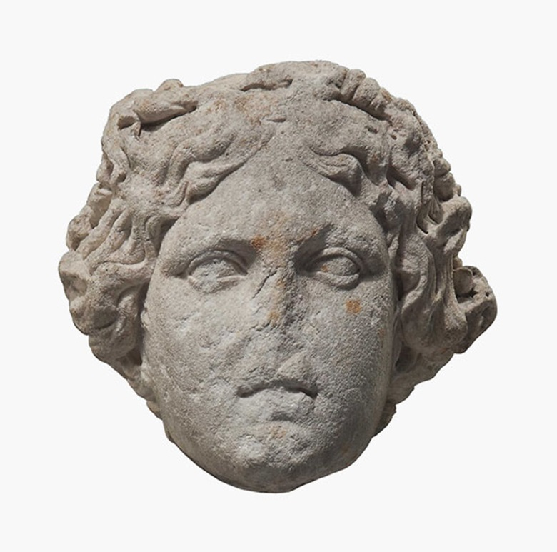A Roman marble head of a goddess wearing a foliate and berried wreath. 1st-2nd century AD. 13 in (33 cm) high on later stand. Estimate £17,000-25,000. This lot is offered in Interiors on 26 October 2016 at Christie's in London, South Kensington