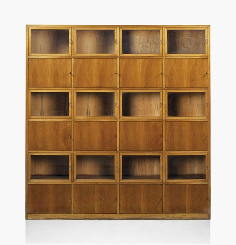 Carlo de Carli (1910-1999),  a cabinet, 1949. Walnut, glass, brass, acrylic. 80¾ in (205 cm) high; 75 in (190.5 cm) wide; 15 in (38 cm) deep. Estimate £4,000-6,000. This lot is offered in Design on 26 October 2016 at Christie's in London, King Street