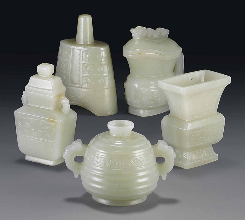 A group of five celadon jade miniature archaistic vessels. 19th century. 2⅜ in (6.1 cm) max. high. This lot was offered in Chinese Ceramics & Works of Art  on 8 November 2016 at Christie's in London and sold for £10,000