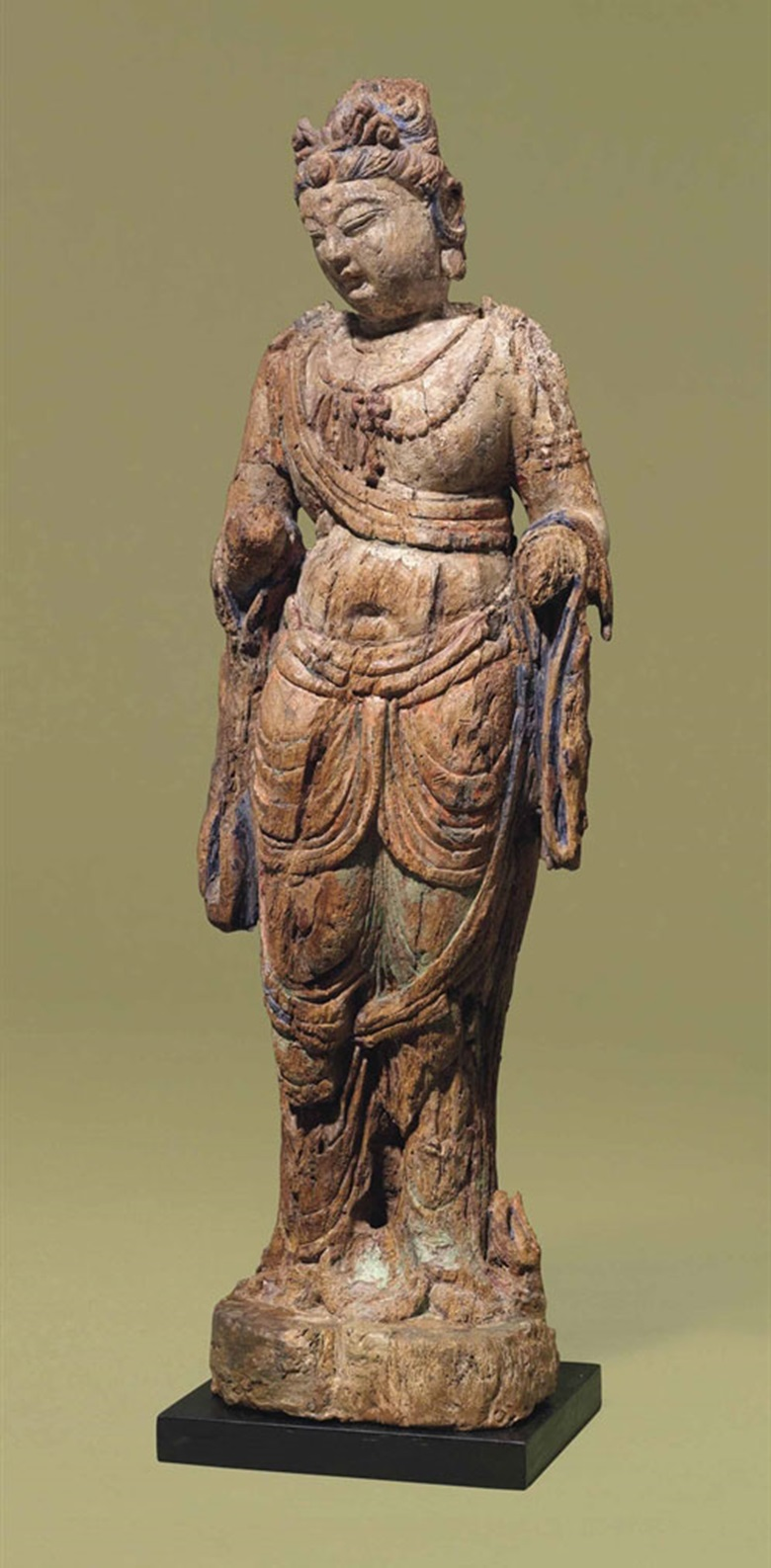 A polychrome wood figure of Guanyin. Yuan-Ming dynasty, 14th century. 29⅞ in (76 cm) high. This lot was offered in Chinese Ceramics & Works of Art  on 8 November 2016 at Christie's in London, King Street
