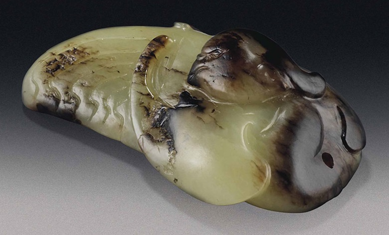 A yellow and brown jade phoenix. Song dynasty (960-1279). 2⅞ in (7.4 cm) long. This lot was offered in Chinese Ceramics & Works of Art  on 8 November 2016 at Christie's in London, King Street