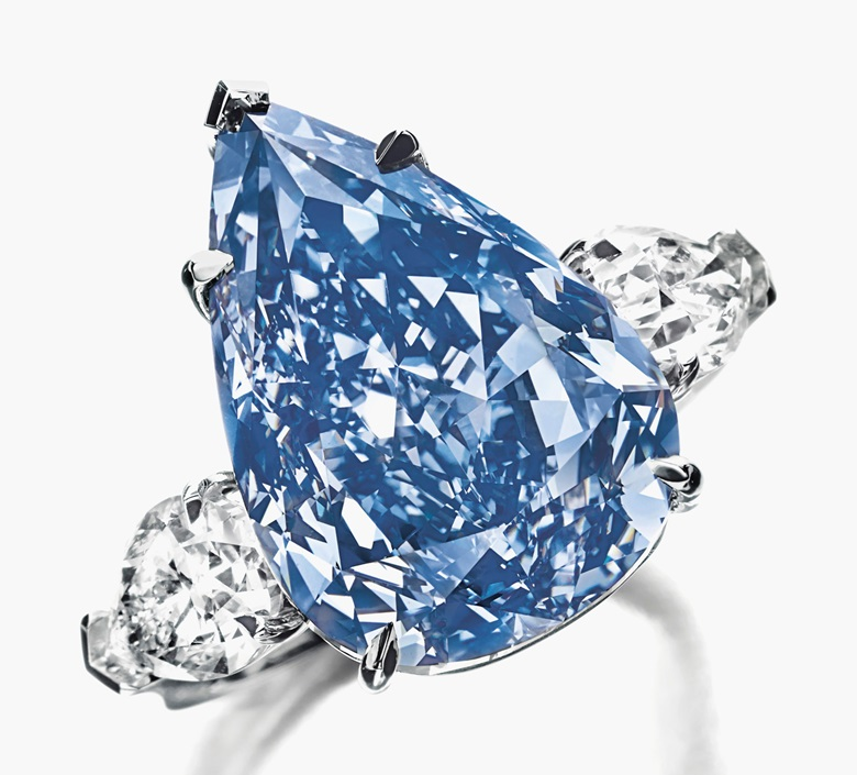 The Blue. The Fancy Vivid Blue pear-shaped diamond, weighing approximately 13.22 carats, flanked on either side by a pear-shaped diamond weighing approximately 1.00 and 0.96 carat. Sold for SFr21,445,000 on 14 May 2014