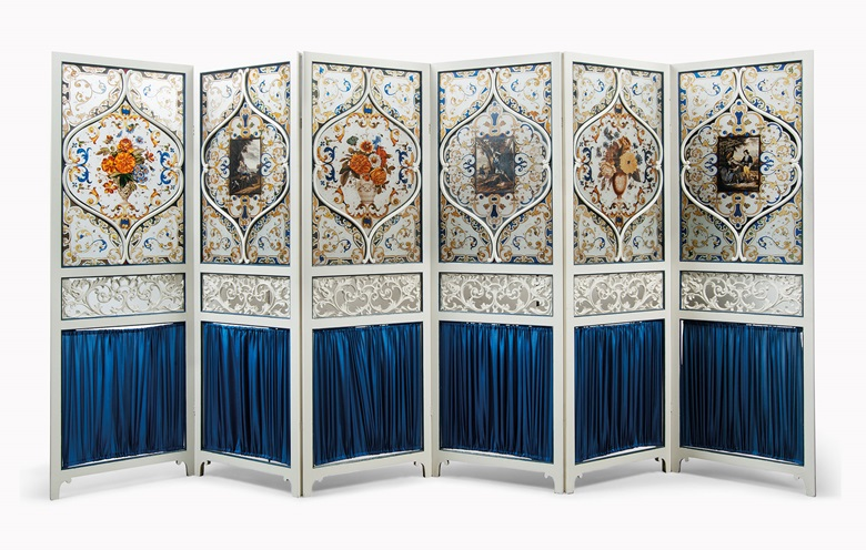 A painted glass, white-painted and pleated material six-fold screen, late 19th century. Each panel 72 ¾ in (185 cm) high; 24 in (61 cm) wide. Estimate £1,200-1,800. This lot is offered in Christies Interiors on 23 November 2016 at Christie's in London, South Kensington