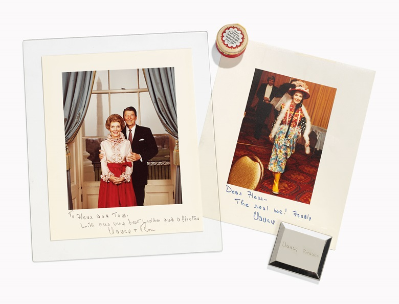 Of Ronald and Nancy Reagan interest; Two photographs and an American silvered metal compact. Late 20th century. The compact 2⅞ x 2 ½ in (7.3 x 6.5 cm). Estimate £800-1,200. This lot is offered in Christies Interiors on 23 November 2016 at Christie's in London, South Kensington