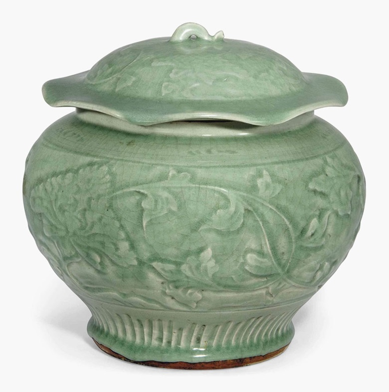 A large Longquan celadon jar and cover. Yuan-ming dynasty, 14th century. 9⅞ in (25 cm) high. This lot was offered in Chinese Ceramics, Works of Art and Textiles Part II on 11 November 2016 at Christie's in London and sold for £7,500