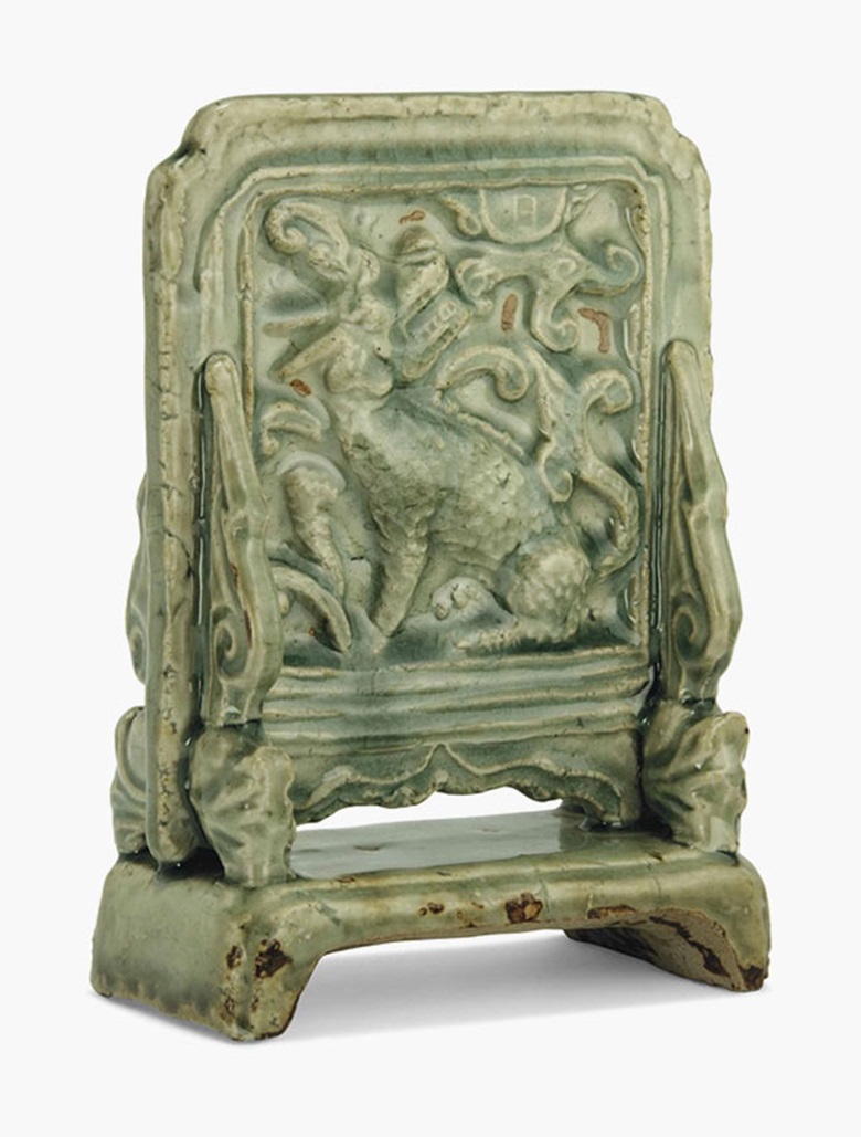 A Longquan celadon xiniu and moon table screen. Ming dynasty (1368-1644). 7⅛ in (18.2 cm) high. This lot was offered in Chinese Ceramics, Works of Art and Textiles Part II on 11 November 2016 at Christie's in London, South Kensington