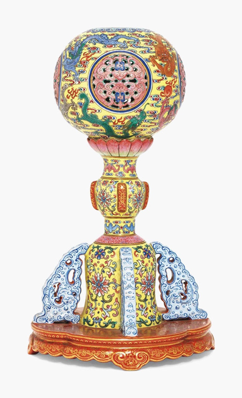 An imperial and very rare yellow-ground famille rose Nine Dragons hat stand. Daoguang six-character seal mark in gilt and of the period (1821-1850). 10¾ in (27.3 cm) high. Estimate £200,000-300,000. This lot is offered in Fine Chinese Ceramics and Works of Art on 8 November 2016 at Christie's in London, King Street