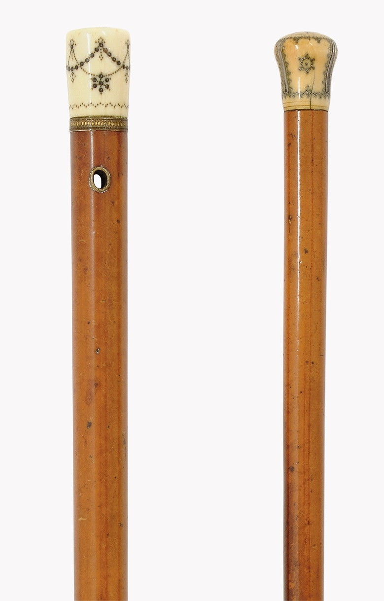 A George III inlaid-ivory and malacca walking cane, second half 18th century; and a silver-piqué inlaid ivory and malacca walking cane, early 18th century. Sold for £2,125 in September 2015 at Christie's London