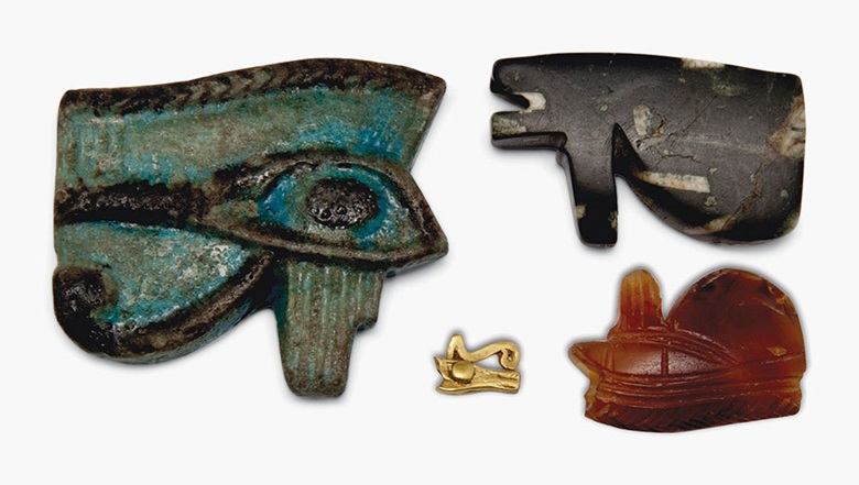 Four wedjet-eye amulets. Egypt, Late Period-Ptolemaic Period, c. 664-30 B.C. 1¾ in (4.5 cm) long, and smaller. Estimate £1,500-2,500. This lot is offered in Seward Kennedys Cabinet of Curiosities and The Tony Robinson Collection of Treen Drinking Vessels on 22 November 2016 at Christie's in London, South Kensington